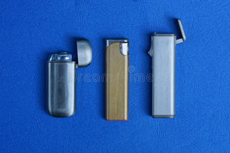 Set of three old metal lighters stock photos