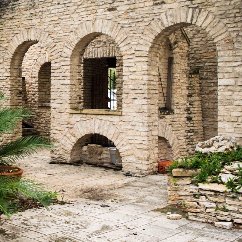 Set of Three Stone Arches into corridor patio. Southwest architecture on patio with corridor into buildings. Stone and brickwork. Custom design stock photos
