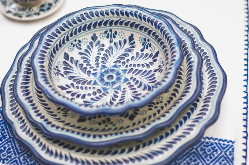 Talavera dishes. Set of three talavera plates with flower design and leaves royalty free stock photo