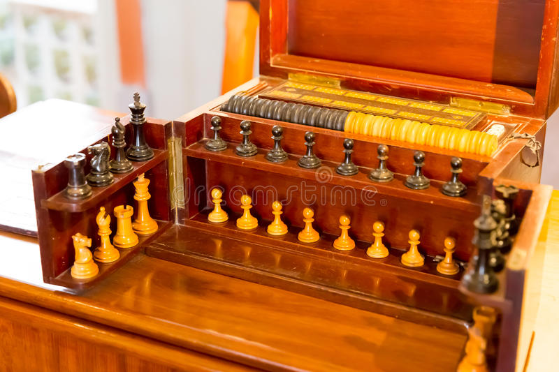 Set to play chess and draughts. Vintage wooden chess set closeup stock photography