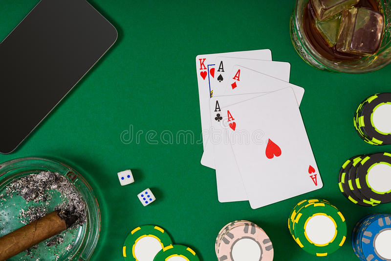 Set to playing poker with cards and chips on green background. Top view. Still life. Copy Space stock photography
