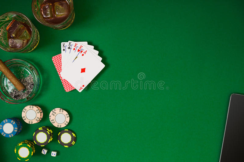 Set to playing poker with cards and chips on green table, top view royalty free stock photography