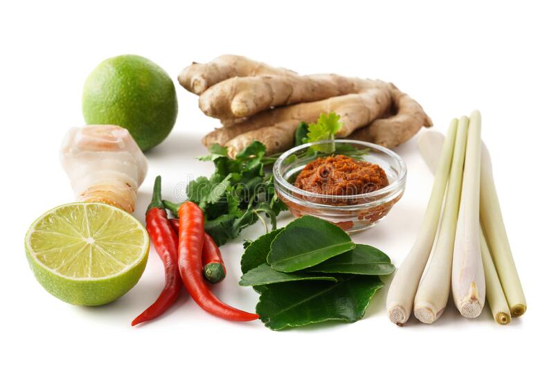 Set of Tom Yum soup basic ingredients for cooking. Isolated. Set of Tom Yum soup basic ingredients - Tom Yum paste, lemon grass, chilli peppers, galanga root stock images
