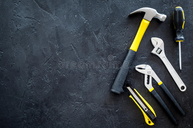 Set of tools for build and repair house on dark background top view mock-up. Set of tools for build and repair house on dark desk background top view mock-up stock images