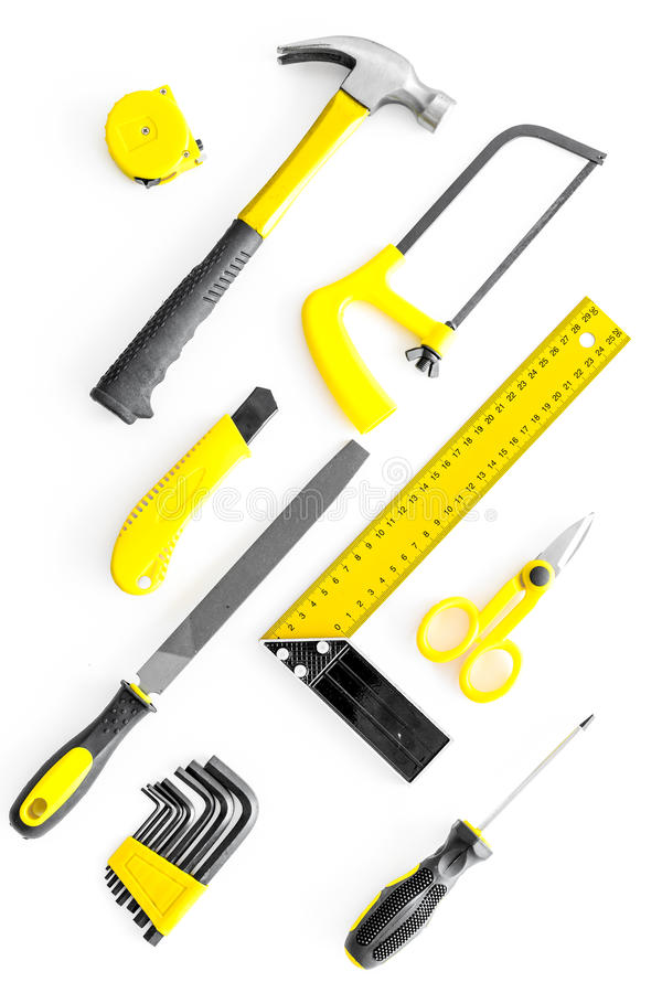 Set of tools for build and repair house on white background top view. Set of tools for build and repair house on white desk background top view stock photos