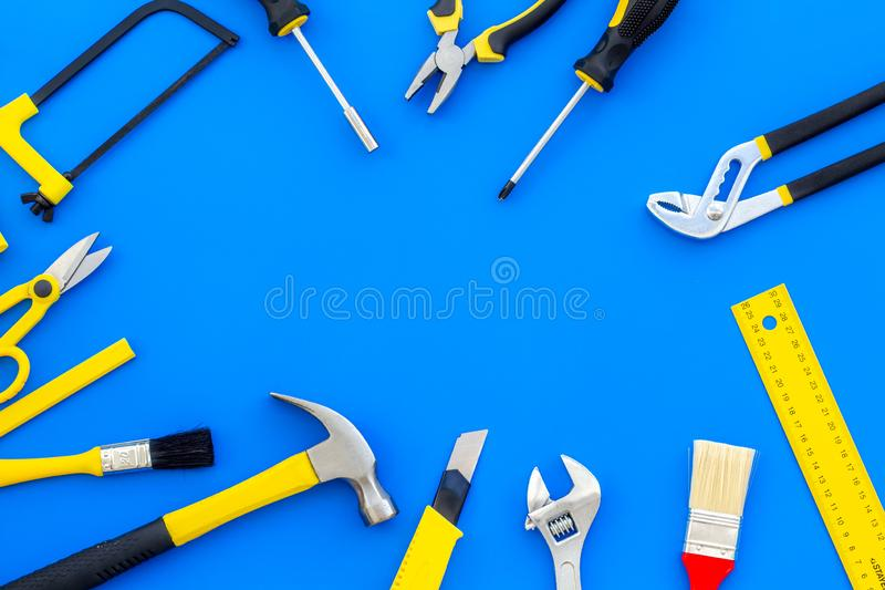 Set of tools for constructor work, build, paint and repair house blue background top view copyspace. Set of tools for constructor work, build, paint and repair stock photo