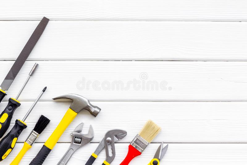 Set of tools for constructor work, build, paint and repair house white background top view copyspace. Set of tools for constructor work, build, paint and repair royalty free stock image