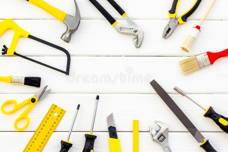 Set of tools for constructor work, build, paint and repair house white background top view copyspace. Set of tools for constructor work, build, paint and repair stock photography