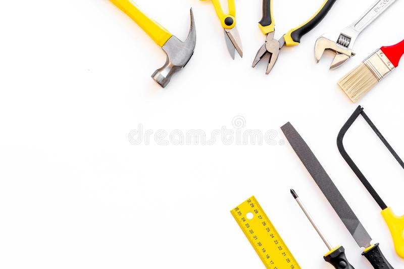 Set of tools for constructor work, build, paint and repair house white background top view copyspace. Set of tools for constructor work, build, paint and repair royalty free stock images
