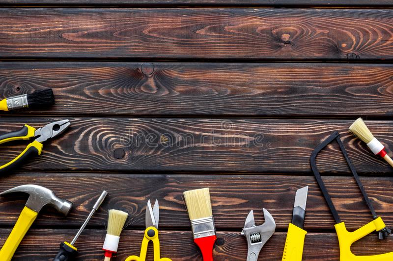 Set of tools for constructor work, build, paint and repair house wooden background top view copyspace. Set of tools for constructor work, build, paint and repair royalty free stock images
