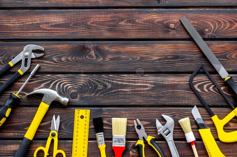Set of tools for constructor work, build, paint and repair house wooden background top view copyspace. Set of tools for constructor work, build, paint and repair stock images