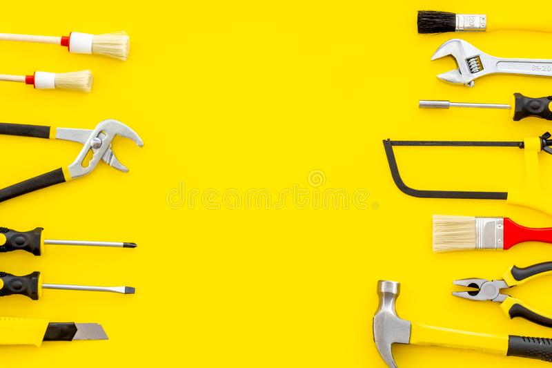 Set of tools for constructor work, build, paint and repair house yellow background top view copyspace. Set of tools for constructor work, build, paint and repair stock photos