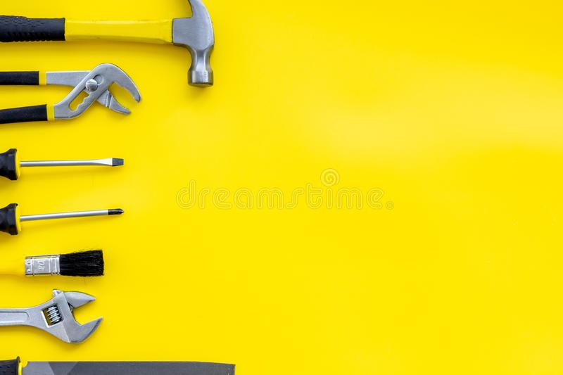 Set of tools for constructor work, build, paint and repair house yellow background top view copyspace. Set of tools for constructor work, build, paint and repair royalty free stock image