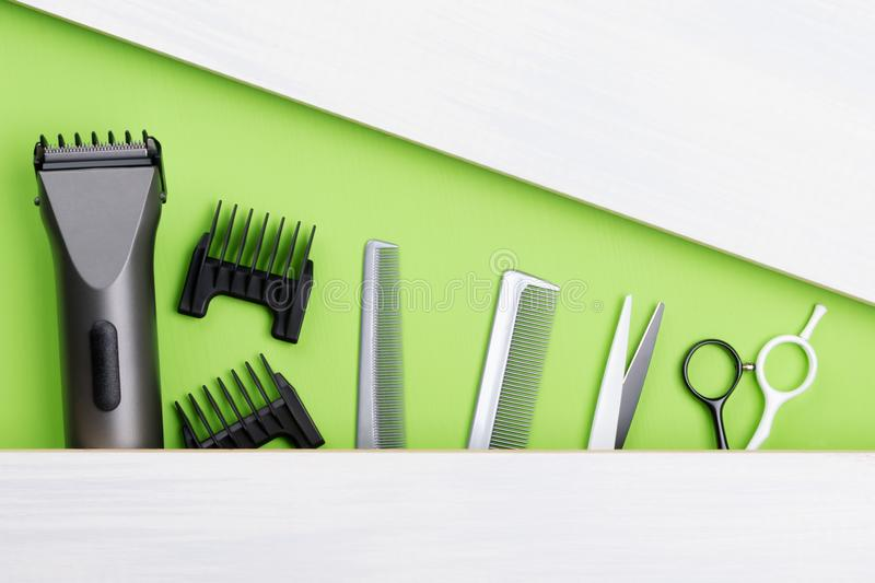 Set of tools for creating a short hairstyle, on a green background royalty free stock images