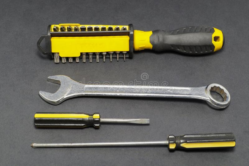 A set of tools on a gray background pliers, screwdriver. royalty free stock photos