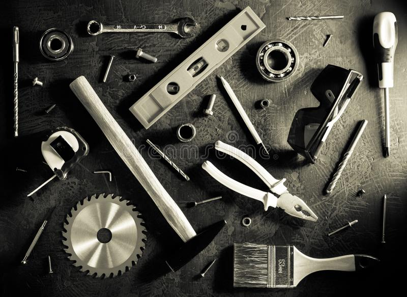 Set of tools and instruments. On black background royalty free stock photos