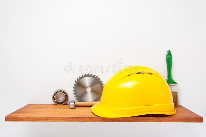 Set of  tools and instruments on shelf at white stock photo