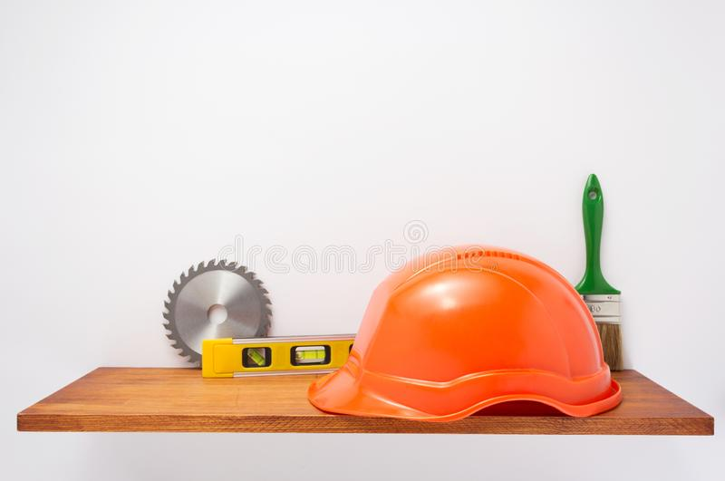 Set of  tools and instruments on shelf at white stock image