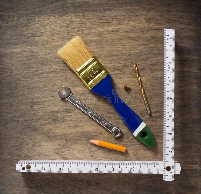 Set of  tools and instruments on wood. En background royalty free stock photos