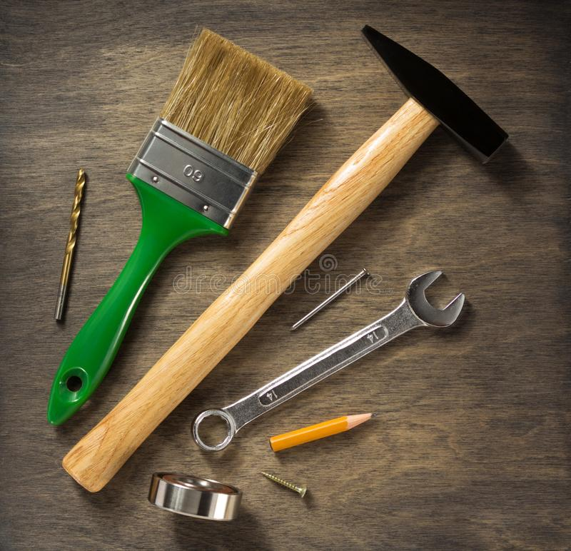 Set of  tools and instruments on wood. En background royalty free stock photo