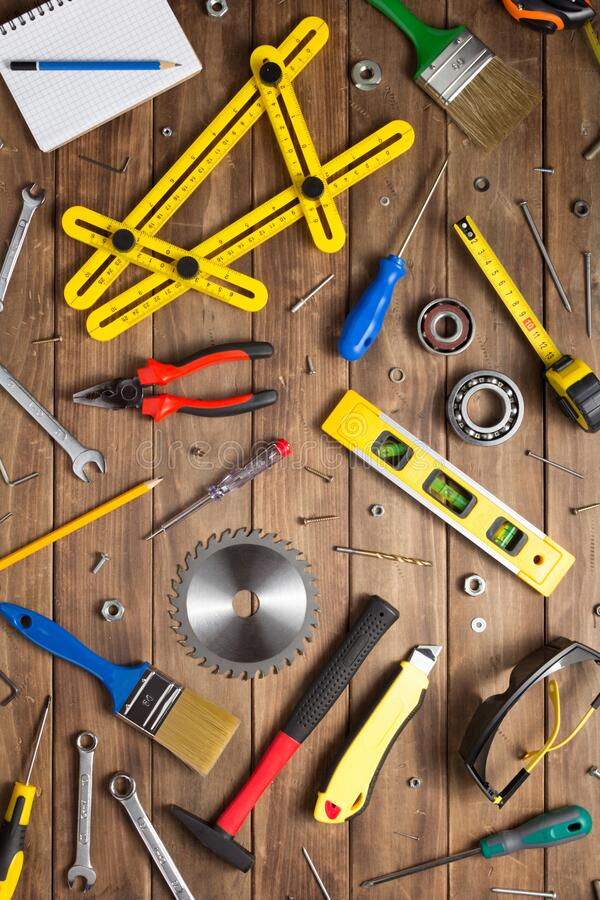 Set of tools and instruments at wooden table royalty free stock images