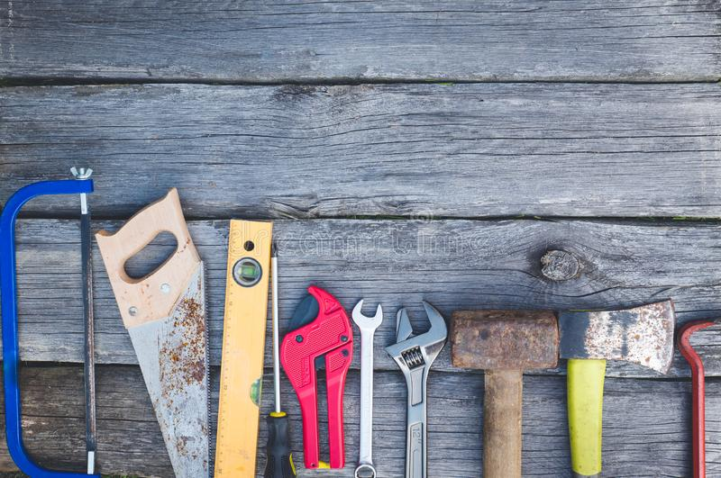 Set of tools over a wood panel with space for text royalty free stock image