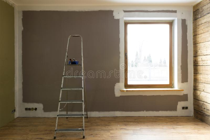 Set of tools for painting wall at home. Home renovation stock images