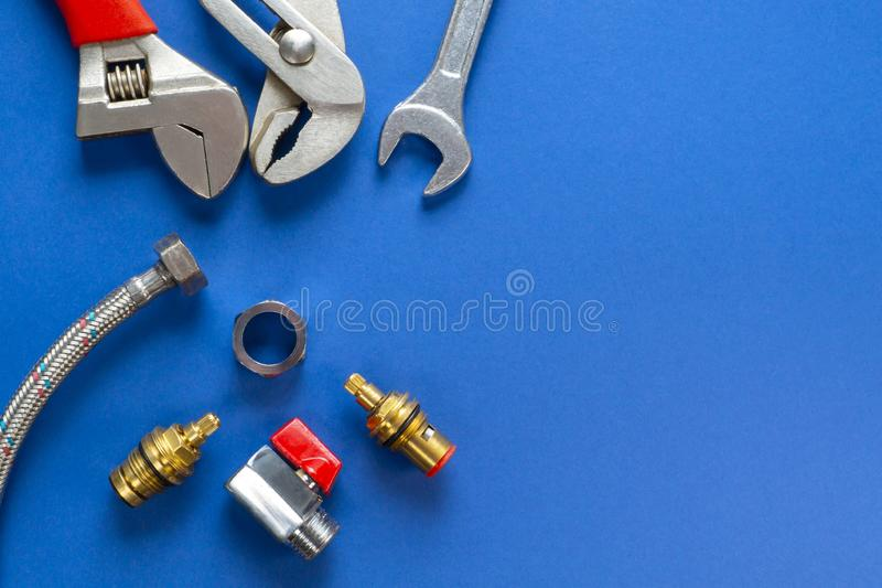 A set of tools for plumbing, isolated on a blue background stock image