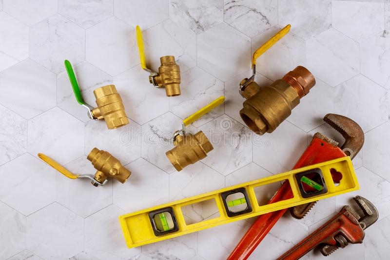 Set of plumbing tools, monkey wrench pipe fittings water valve on level tape. Set tools for plumbing monkey wrench pipe fittings water valve on level tape stock photo