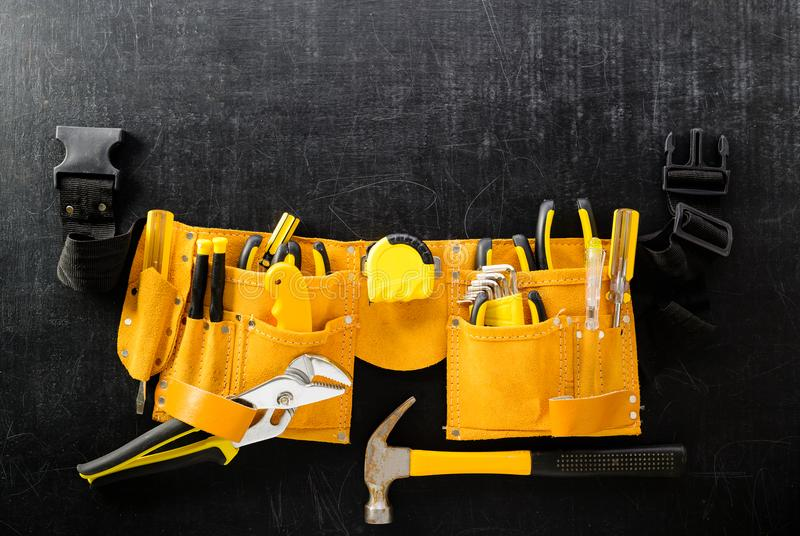 Set of tools in toolbelt tape measure nippers. Concept of DIY an stock photo