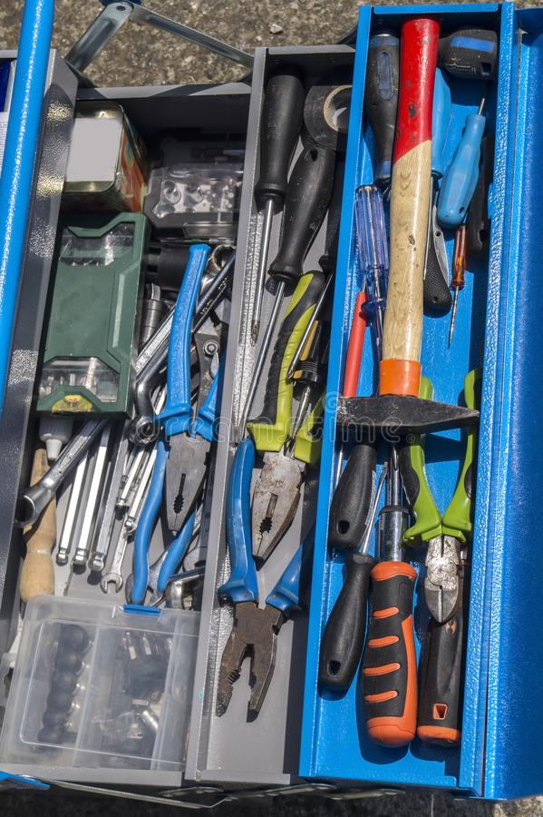 Set of tools on toolbox DIY. Toolset with interior compartments to keep do-it-yourself DIY tools royalty free stock photo