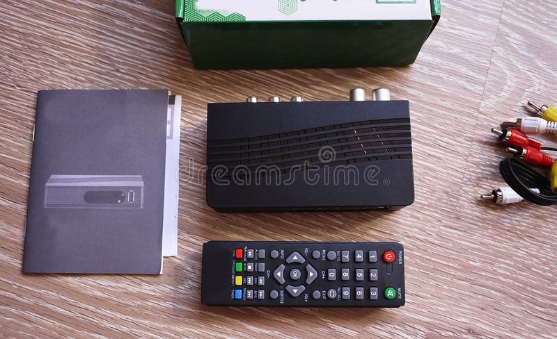 Set-top box for receiving video and TV signal. Remote control. Details and close-up. stock photos