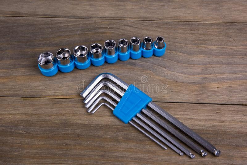 Set of torx and hexagon keys on wooden board stock images