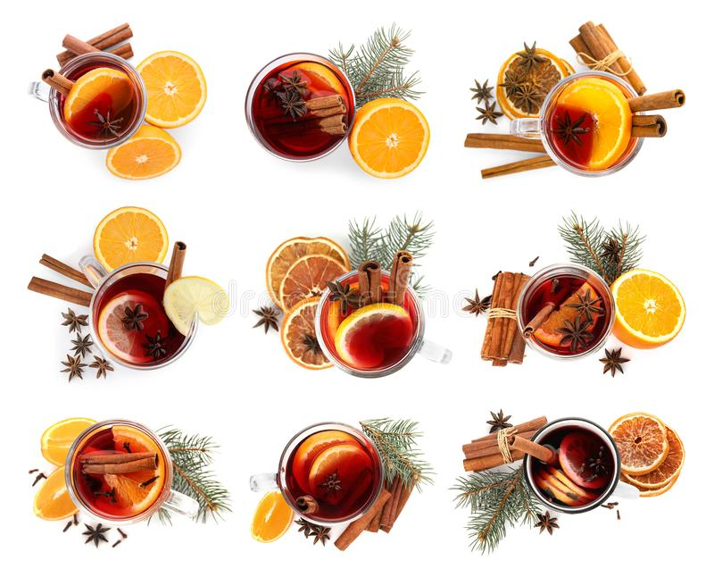 Set of traditional Christmas mulled wine in glasses on white background. Top view royalty free stock images