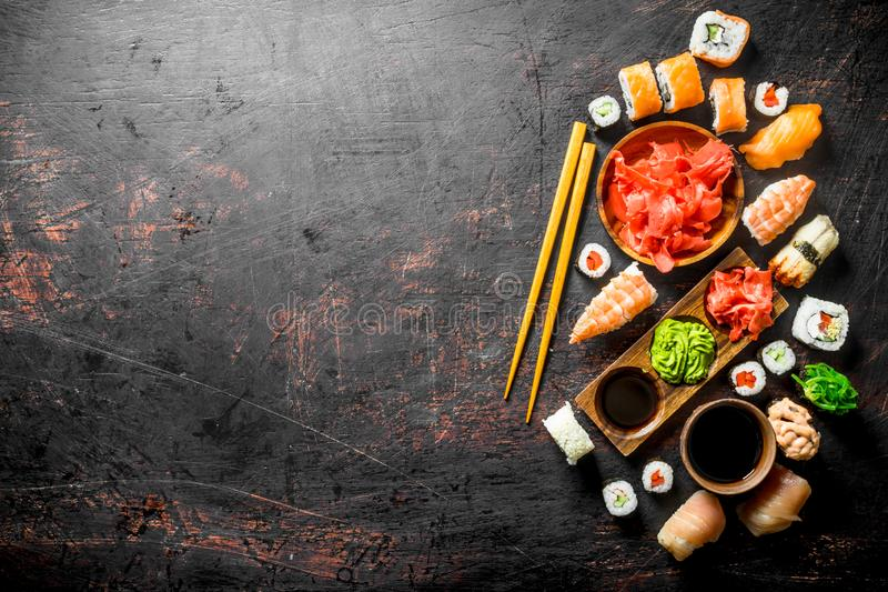 Set of traditional Japanese sushi and rolls with marinated ginger and soy sauce royalty free stock photography