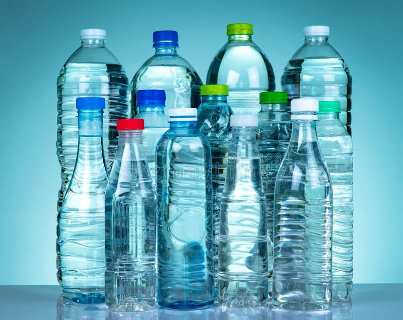 Set of transparent plastic water bottle with blank label. Clear water and natural mineral bottle with white, green, red, and blue royalty free stock photo