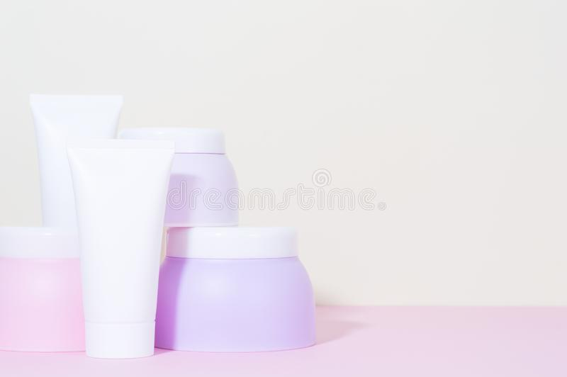 A set tubes of creams. Pastel colors. royalty free stock photography