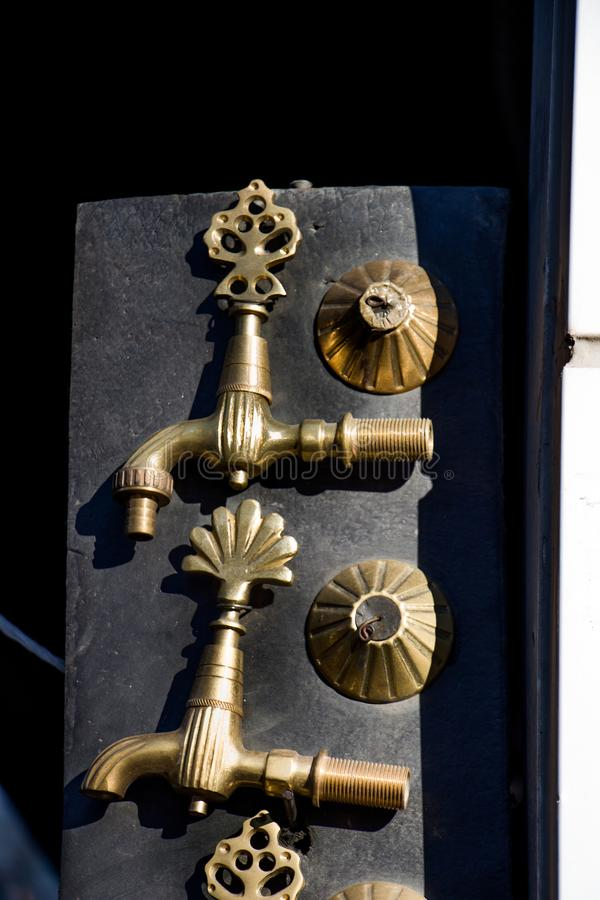 Set of Turkish Ottoman style antique fountain water tap in view stock photos