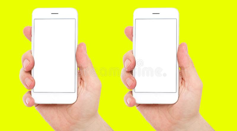Set two different phones with blank display on yellow background, male hands hold phones royalty free stock photo