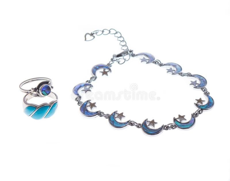 A set of two rings and a necklace. A set of two rings with blue stones and a necklace with blue moon stone royalty free stock photos