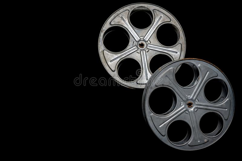 Two vintage film reels on a black background with copy space stock image
