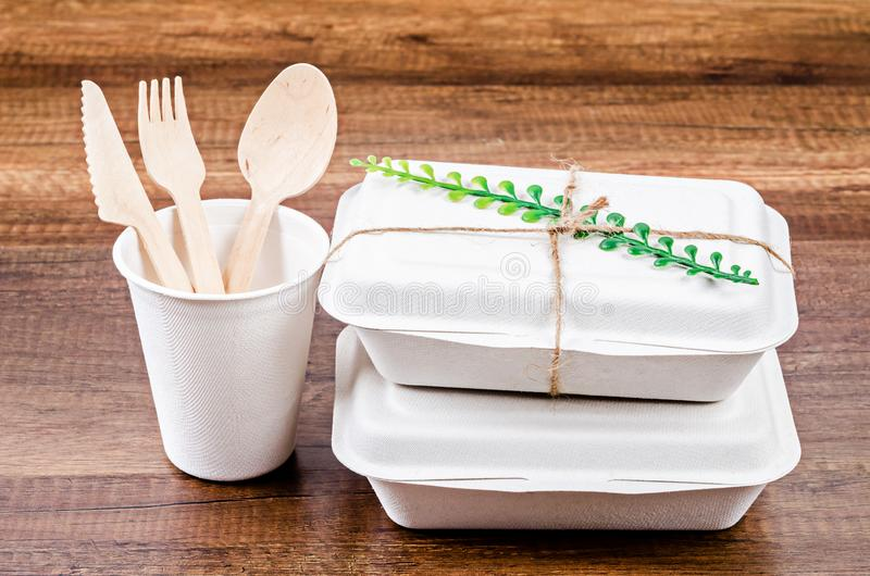 Set of unbleached plant fiber food box and paper coffee cup royalty free stock photos
