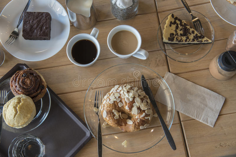 Set up shot of variety bread and cake with hot coffee break. stock image