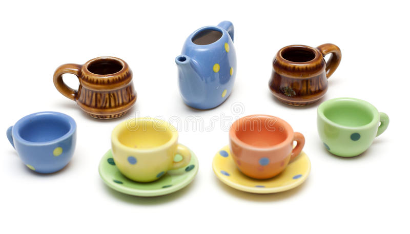 Set of the varicoloured ceramic dishes stock photo