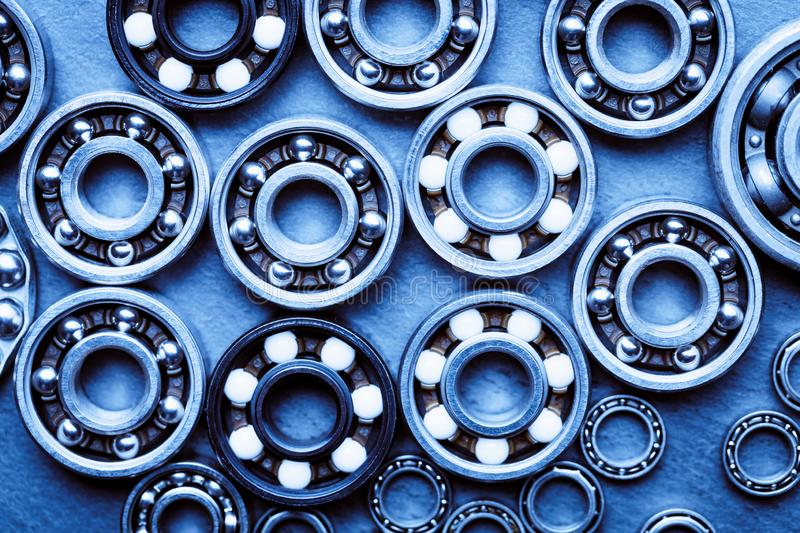 Set of various ball bearings. Technology and machinery industrial background. Blue toned.  royalty free stock images