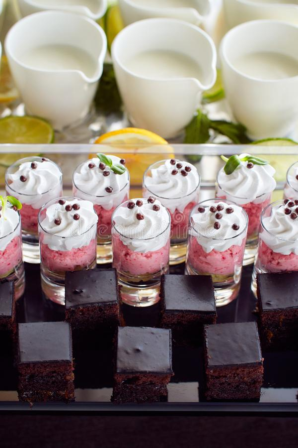 A set of various breakfast sweet desserts on the dark plate stock images