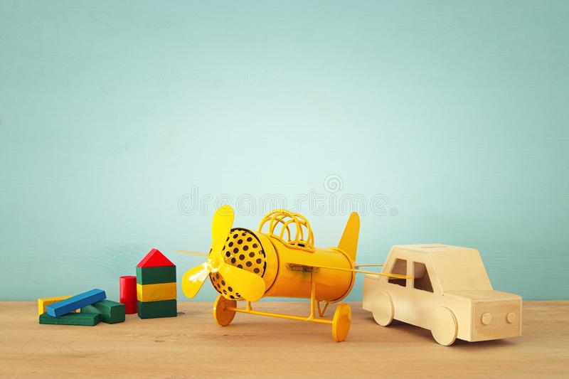 Set of various cars and airplanes toys over wooden table. stock photography