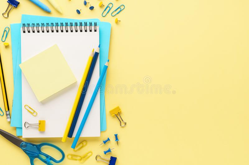 Set of various colorful school stationery on yellow background. Set of various colorful school stationery and supplies on yellow background. Back to school sale royalty free stock images
