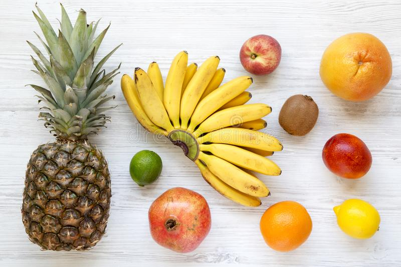 Set of various exotic fruits over white wooden background stock photos