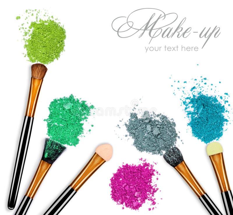 Set of various eyeshadows and make-up brushes on white royalty free stock images